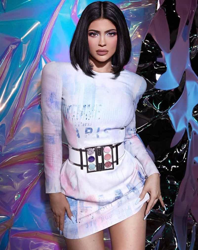 Kylie Jenner in a dress with a Balmain makeup palette belt, via @kyliejenner